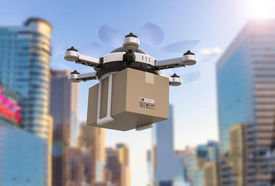 Drone delivering a package in a city.