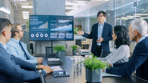 Businessman giving presentation with analytics
