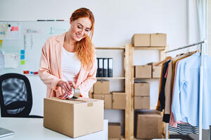 Businesswoman%20packing%20boxes