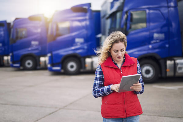 Truck Driver Using Freight Management System on Tablet