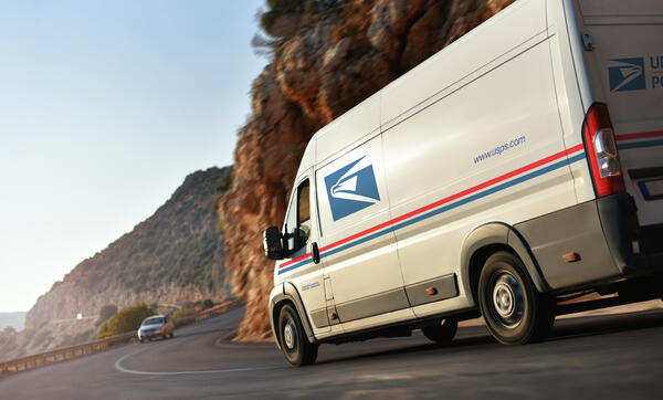 USPS Address Validation Delivery van on the road