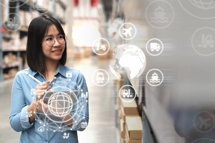 Woman using sap logistics management system